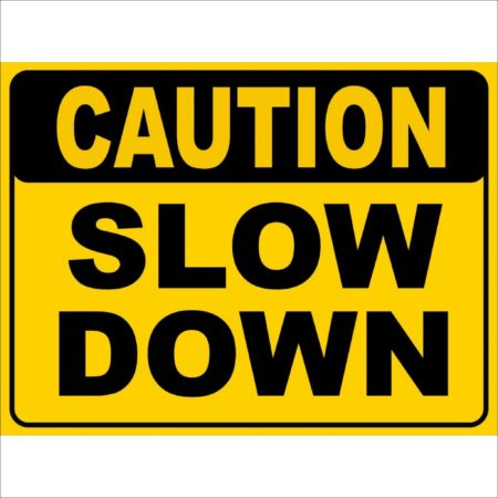 slow down sign representing navigating difficult celestial alignments