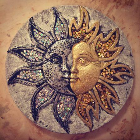 a sun and moon carving representing Akshaya Tritiya